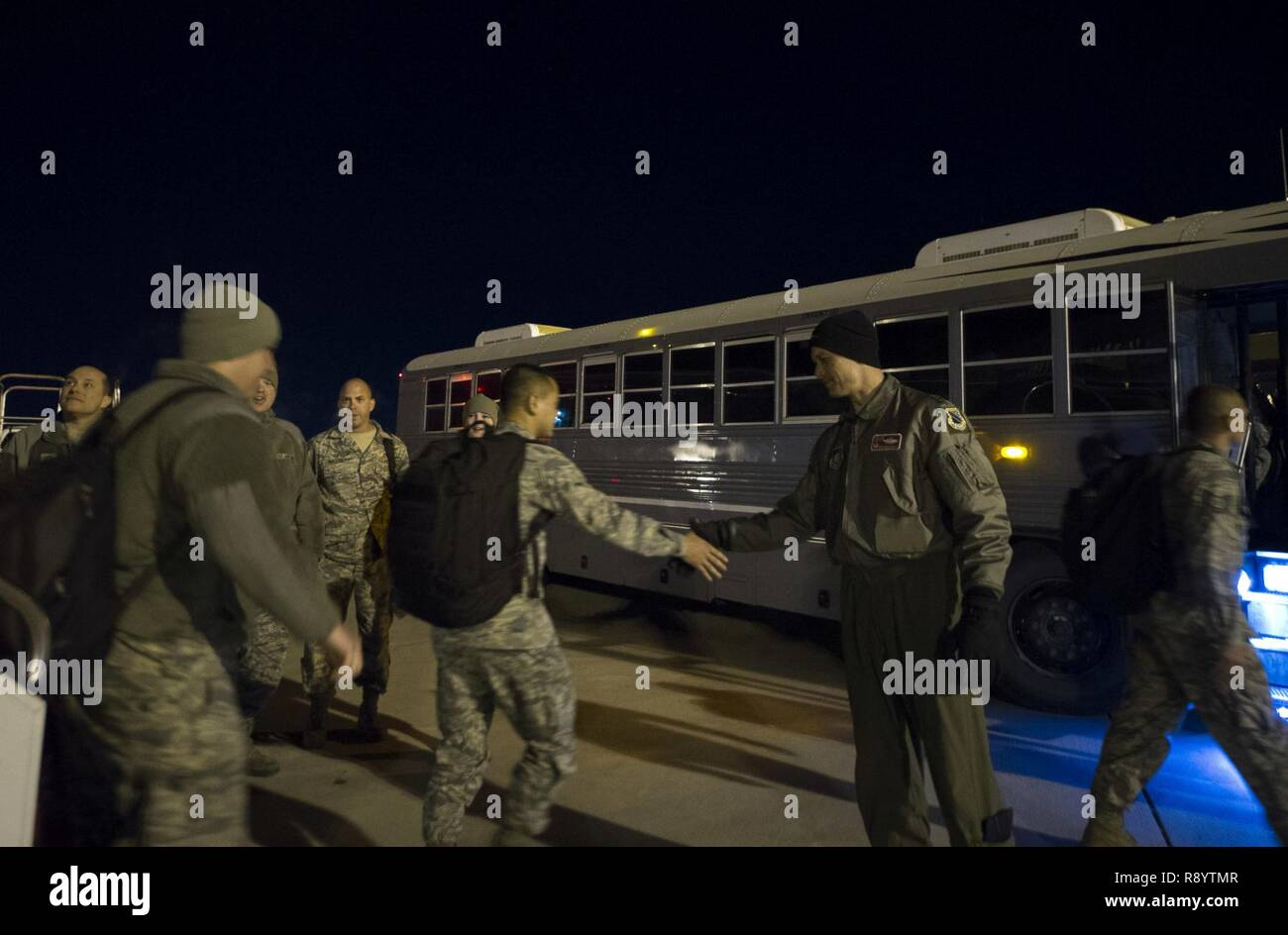 Air Force Lt. Col. David Skalicky, 90th Fighter Squadron commander, greets Airmen after arriving back from Royal Australian Air Force Base Tindal, Northern Territory, Australia, March 18, 2017 at Joint Base Elmendorf-Richardson, Alaska. More than 200 Airmen participated in a bilateral exercise as part of the Enhanced Air Cooperation initiative. - Stock Image