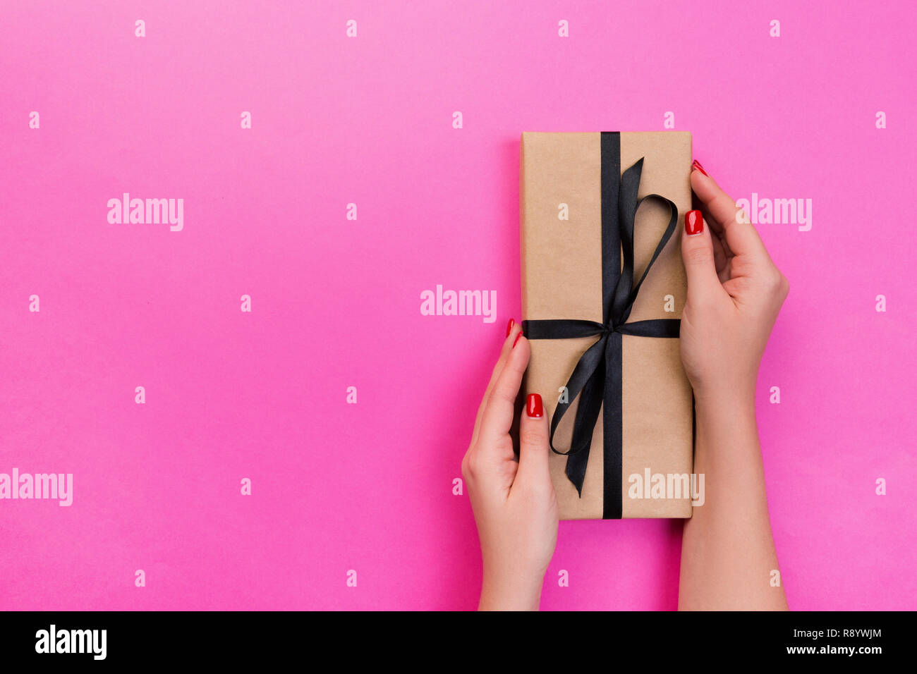 Woman Hands Give Wrapped Valentine Or Other Holiday Handmade Present