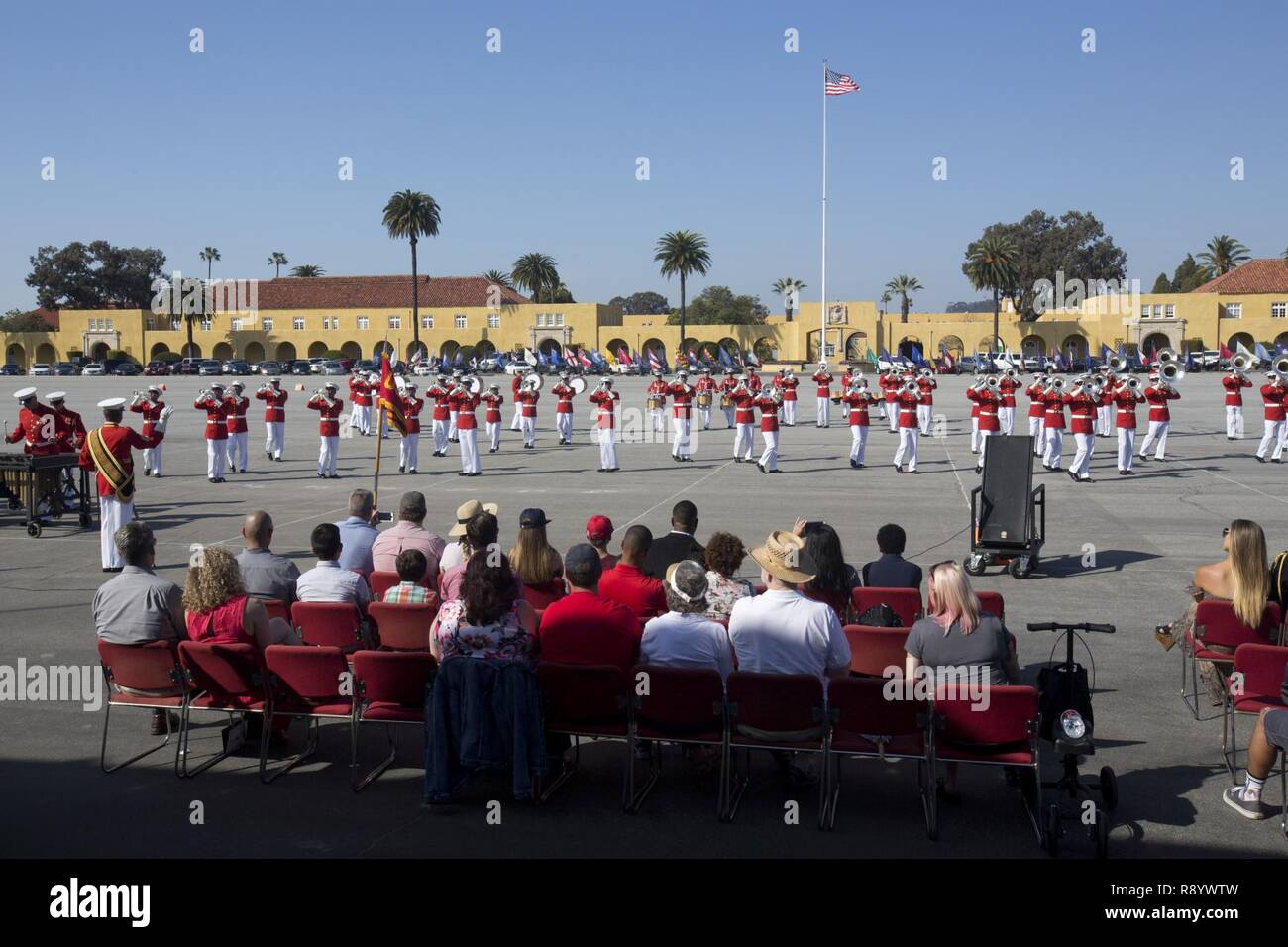U.S. service members, friends, and family attend a Battle Color ceremony at Marine Corps Recruit Depot San Diego, Calif., March 11, 2017. The ceremony included a performance by the Marine Drum and Bugle Corps, the Silent Drill Platoon, and the Marine Corps Color Guard. Stock Photo