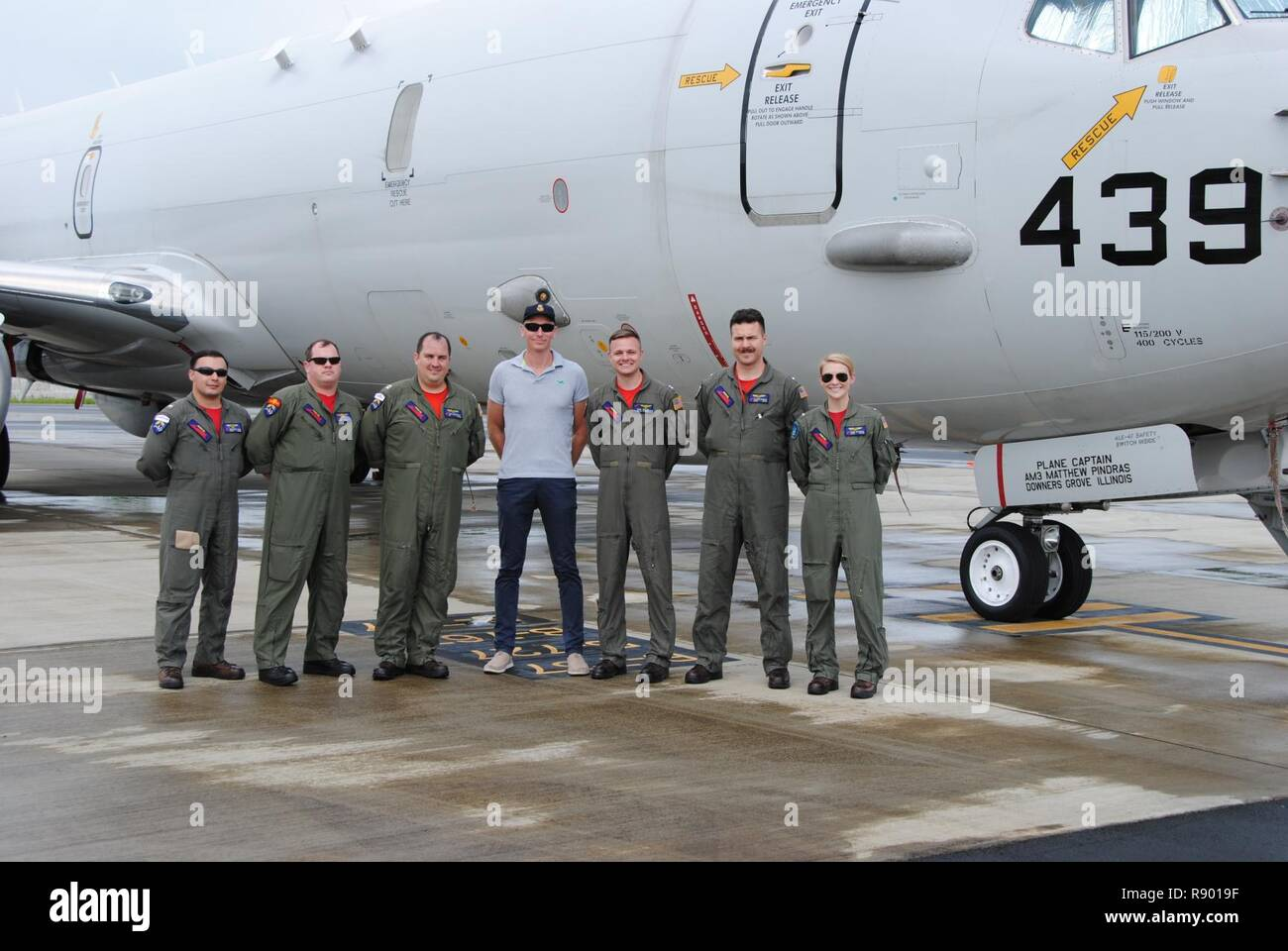 KOROR, Palau (March 11, 2017) The Red Lancers of Patrol Squadron Ten (VP-10) pose in front of the P-8A with their Maritime Surveillance Coordinator after arriving on detachment in Palau. The Red Lancers flew to Palau to participate in Rai Balang, a Forum Fisheries Agency operation that conducted surveillance missions to deter illegal fishing in their national waters and Exclusive Economic Zone (EEZ). - Stock Image