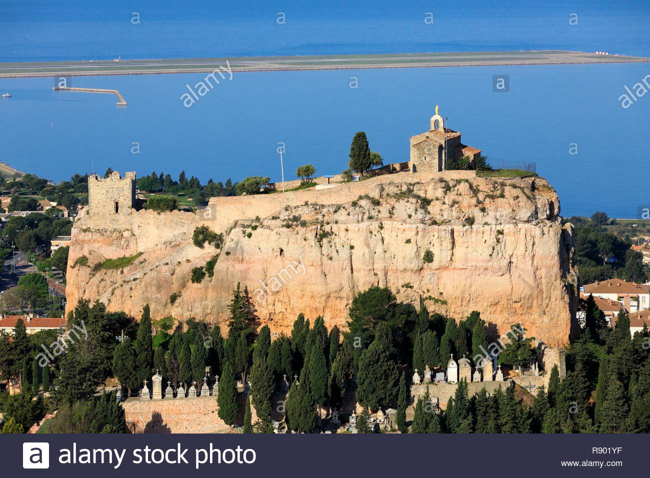 France, Bouches du Rhone, Vitrolles, the rock, Notre Dame de Vie chapel, Sarrasine tower (XI century), listed as a historical monument, the Marseille Provence airport and Etang de Berre in the background (aerial view) - Stock Image