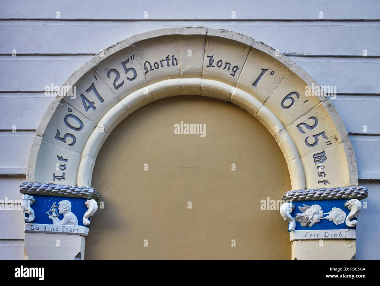 Door frame in the Point area of Portsmouth showing position with guiding stars and fair wind motifs. - Stock Image