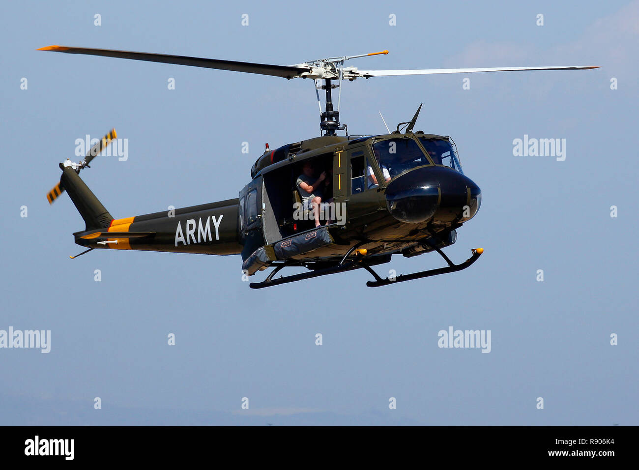 An ex Vietnam Huey helicopter coming in to land at the V&A Waterfront heliport in Cape Town. - Stock Image