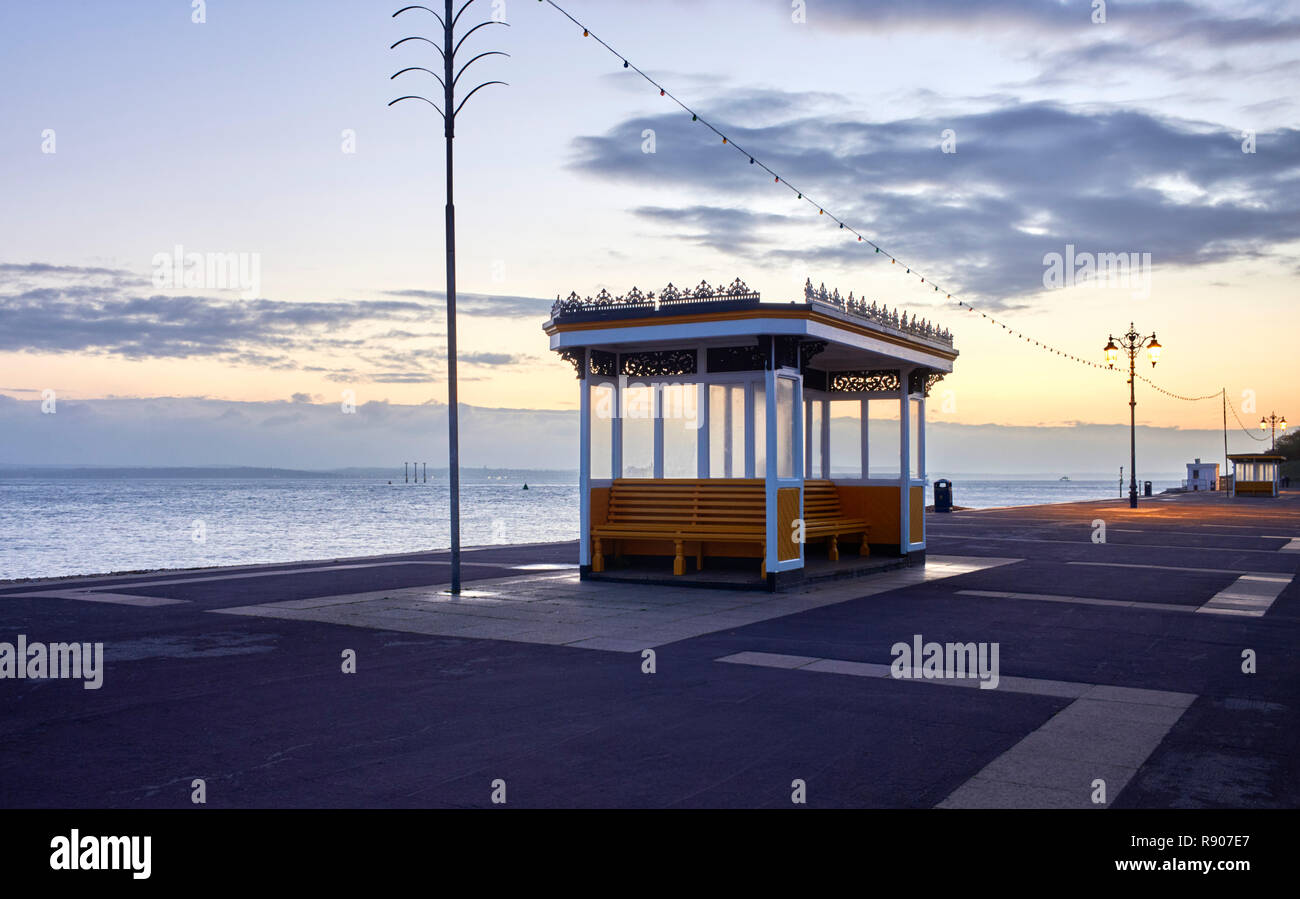 Victorian seaside shelters at Southsea overlooking the Solent at dusk on a winter evening - Stock Image