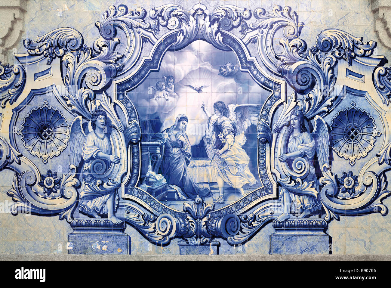 Blue and white historic tile painting with religious motive - Stock Image