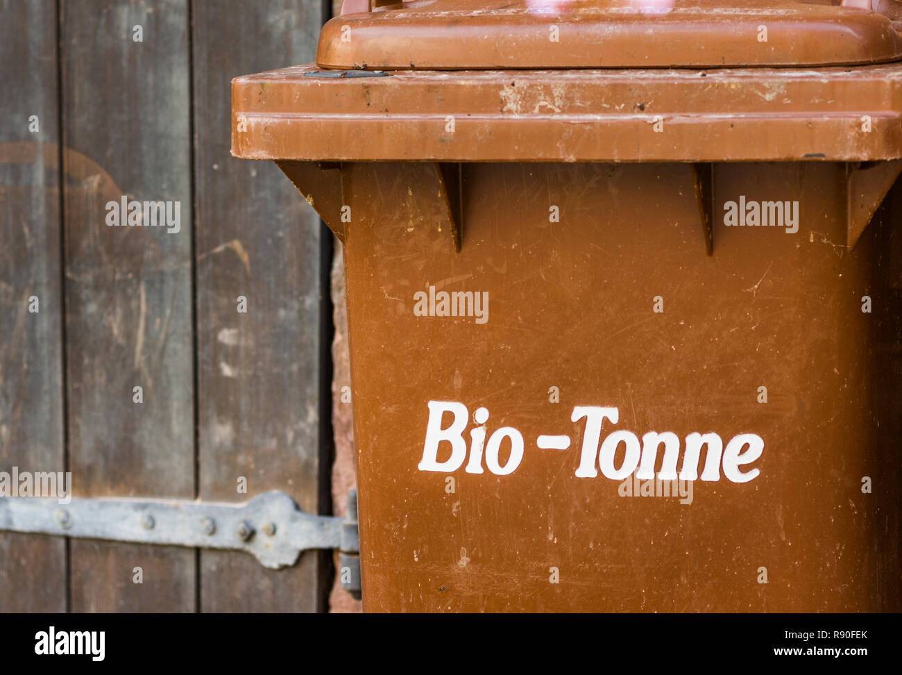"""brown trashcan with the german inscription: """"bio-tonne"""", trashcan for organic waste Stock Photo"""