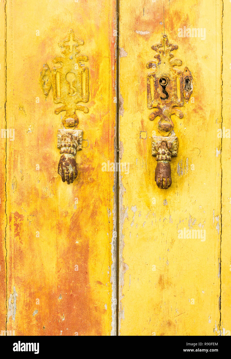 historic doorknockers in the form of hands - Stock Image