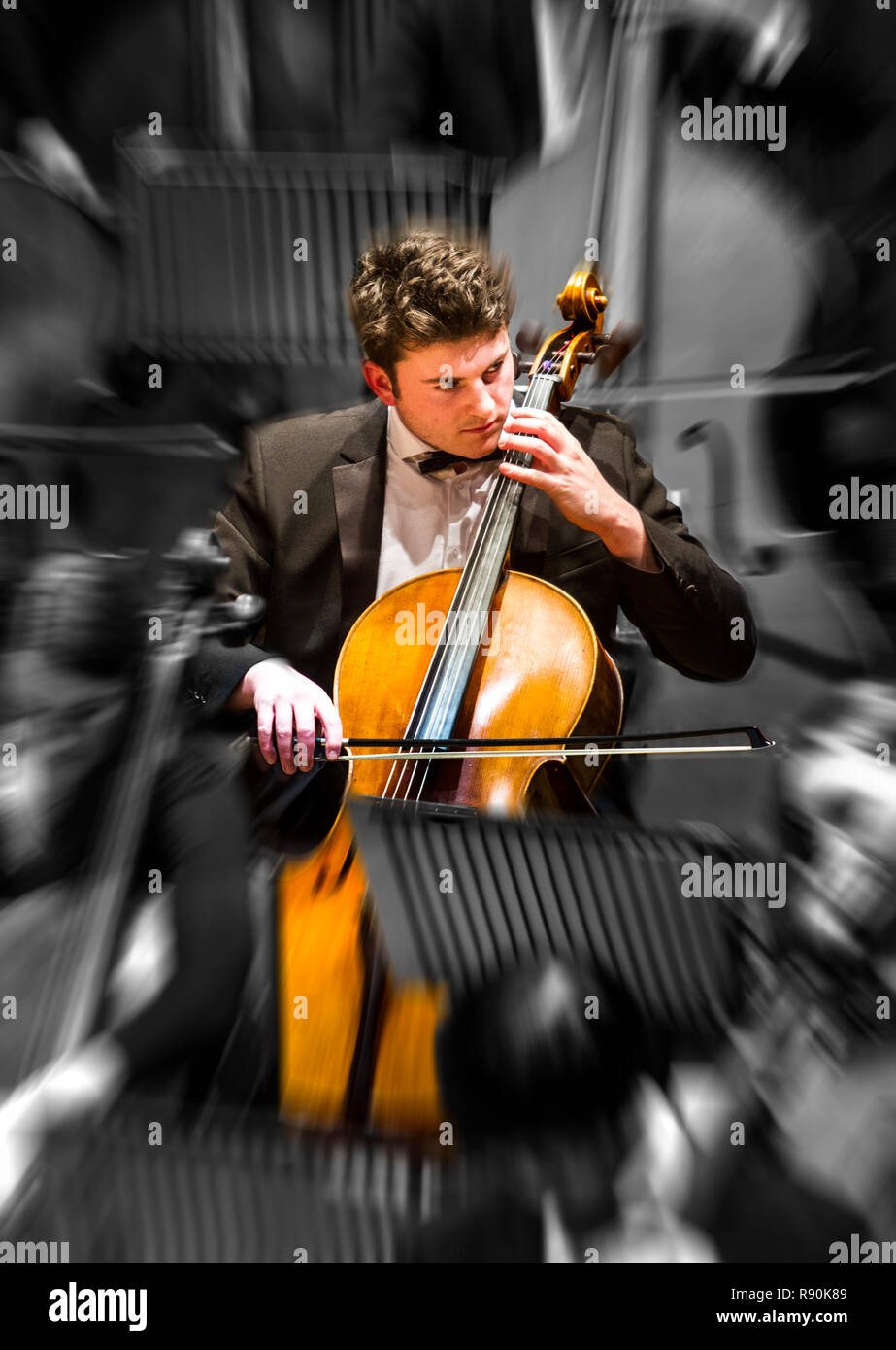 Stylised image of a young Cellist playing his cello - Stock Image