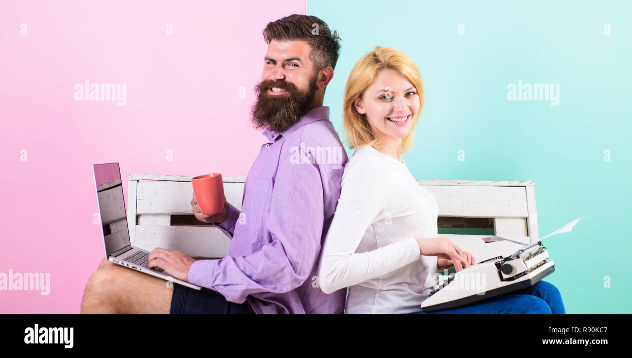Original authentic attribute writer. Couple writers use different gadgets write book. True autor authentic equipment. Colleagues different work approach. Man use laptop girl like retro typewriter. - Stock Image