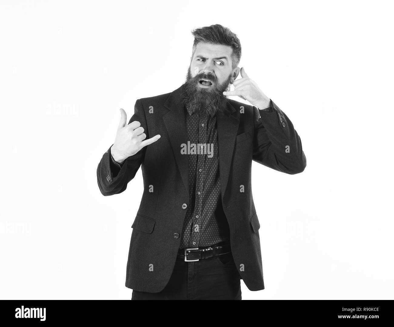 Bad phone service. Bearded man shows call me gesture. Hipster with long beard and unsatisfied face. Mature man wears smart suit. Mobile, success, negative emotions, business, multitasking concept. - Stock Image