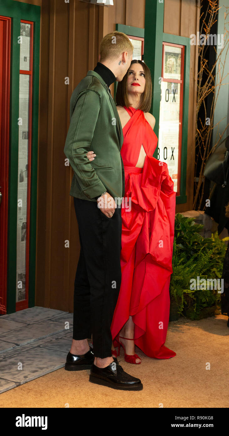 Colson Baker and Sandra Bullock attend the New York screening of 'Bird Box' at Alice Tully Hall Lincoln Center (Photo by Lev Radin / Pacific Press) - Stock Image