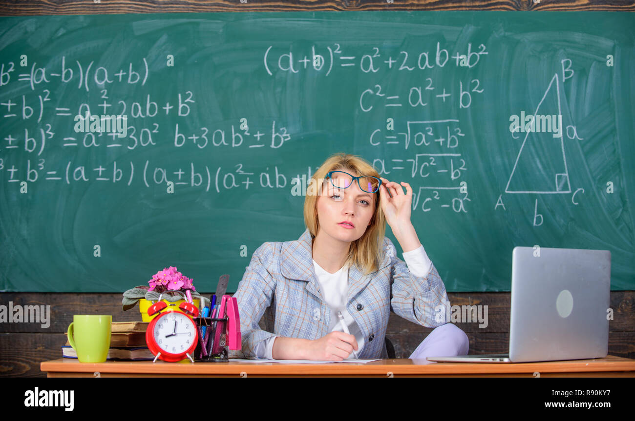 Teacher doubtful face listening you. She has doubts in your report or  knowledge. Teacher