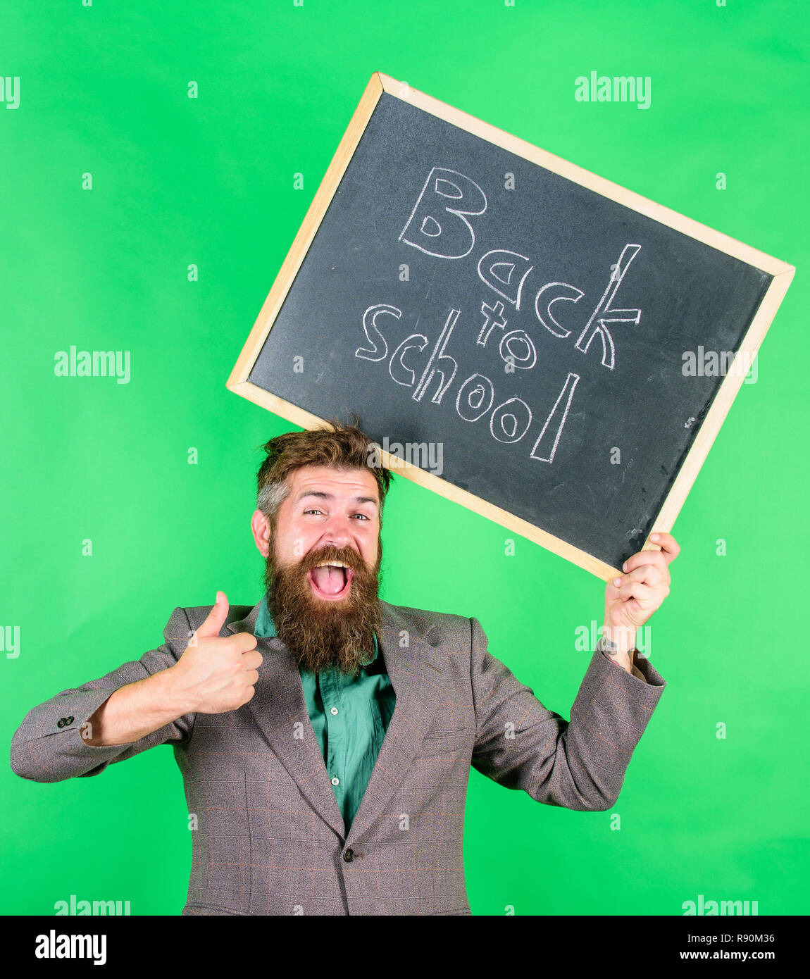 Special offer discount sale school season. Apply for sensational educational offer. Back to school special offer. Man bearded teacher holds blackboard back to school inscription on green background. - Stock Image
