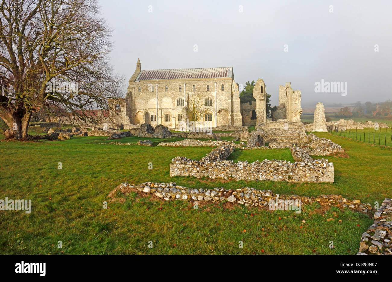A view of the Priory Church and excavated Benedictine monastic ruins at Binham, Norfolk, England, United Kingdom, Europe. - Stock Image