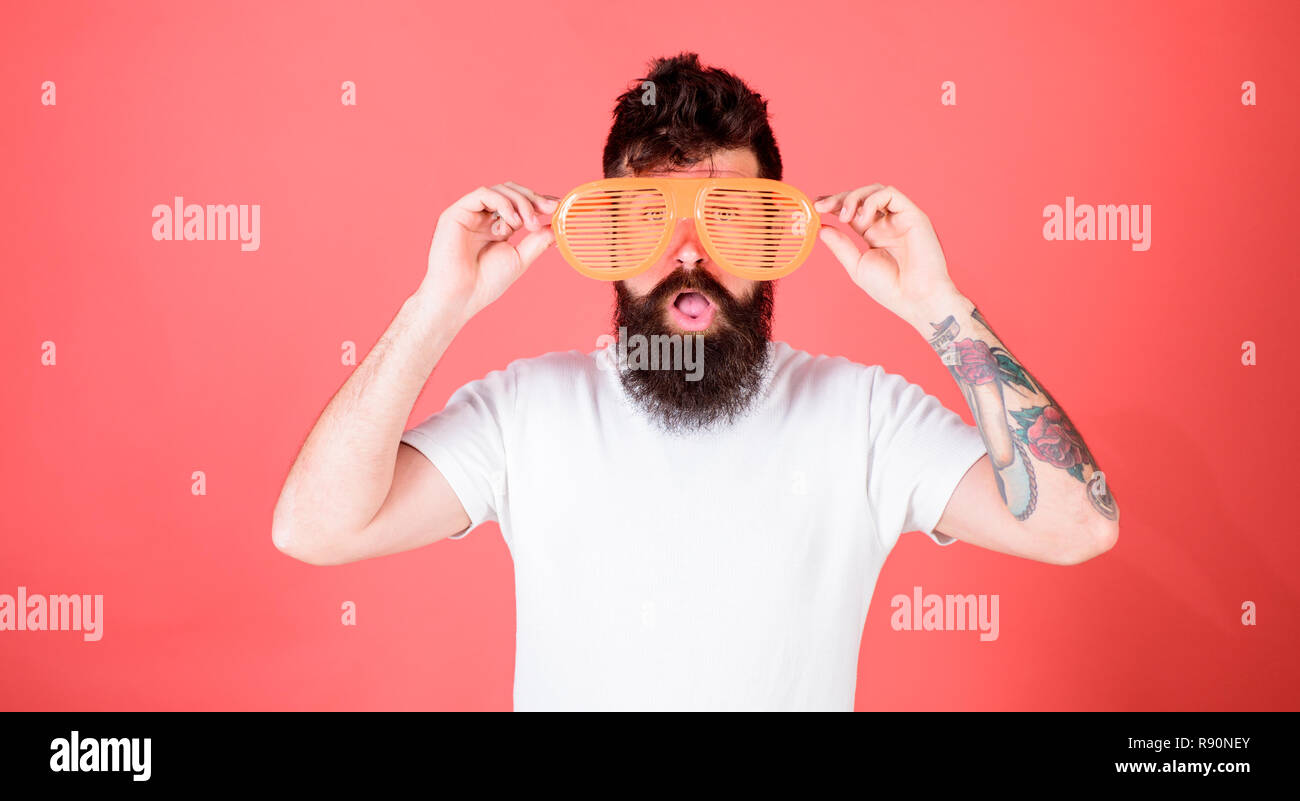 Sunglasses party attribute and stylish accessory. Hipster wear shutter shades sunglasses. Man bearded hipster wears giant louvered sunglasses. Eye protection accessory concept. Fashionable accessory. - Stock Image