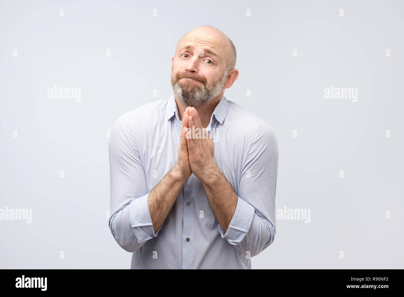 Please help me now. Bearded mature man need a help. - Stock Image