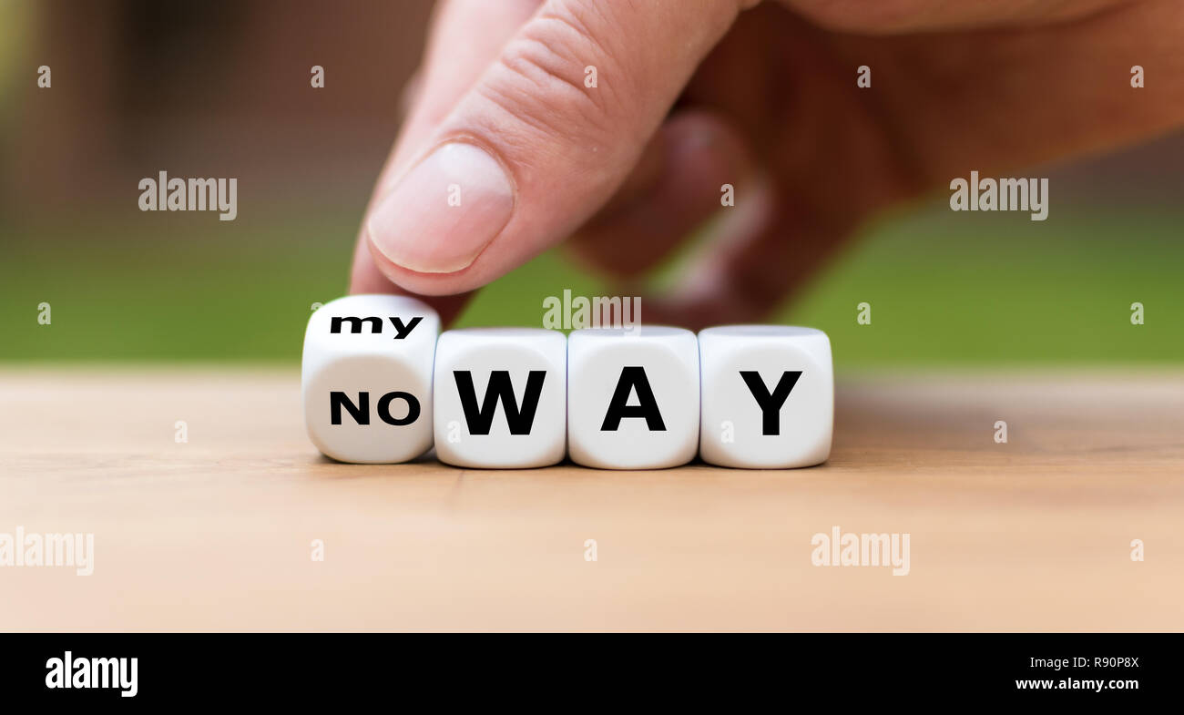 """Hand is turning a dice and changes the expression """"no way"""" to """"my way"""" Stock Photo"""