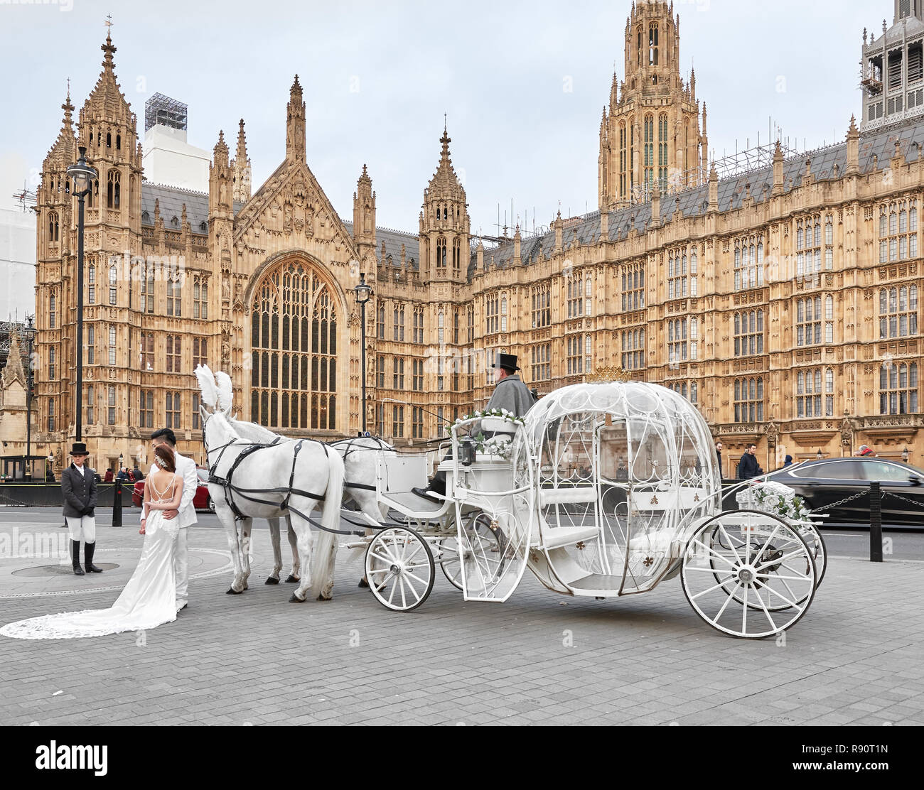 Chinese Married Couple Dressed In White Pose For Fairy Tale Wedding Photos With White Carriage Drawn By Two White Horses Outside Parliament London Stock Photo Alamy