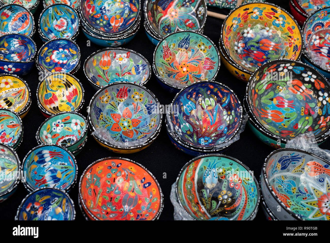 Colourful handmade pottery bowls on a stall at a victorian christmas market. Stratford Upon Avon, Warwickshire, England - Stock Image