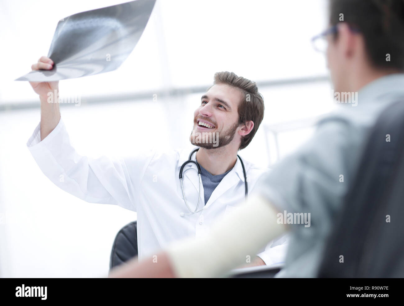 orthopedist examining a radiograph of a patient - Stock Image