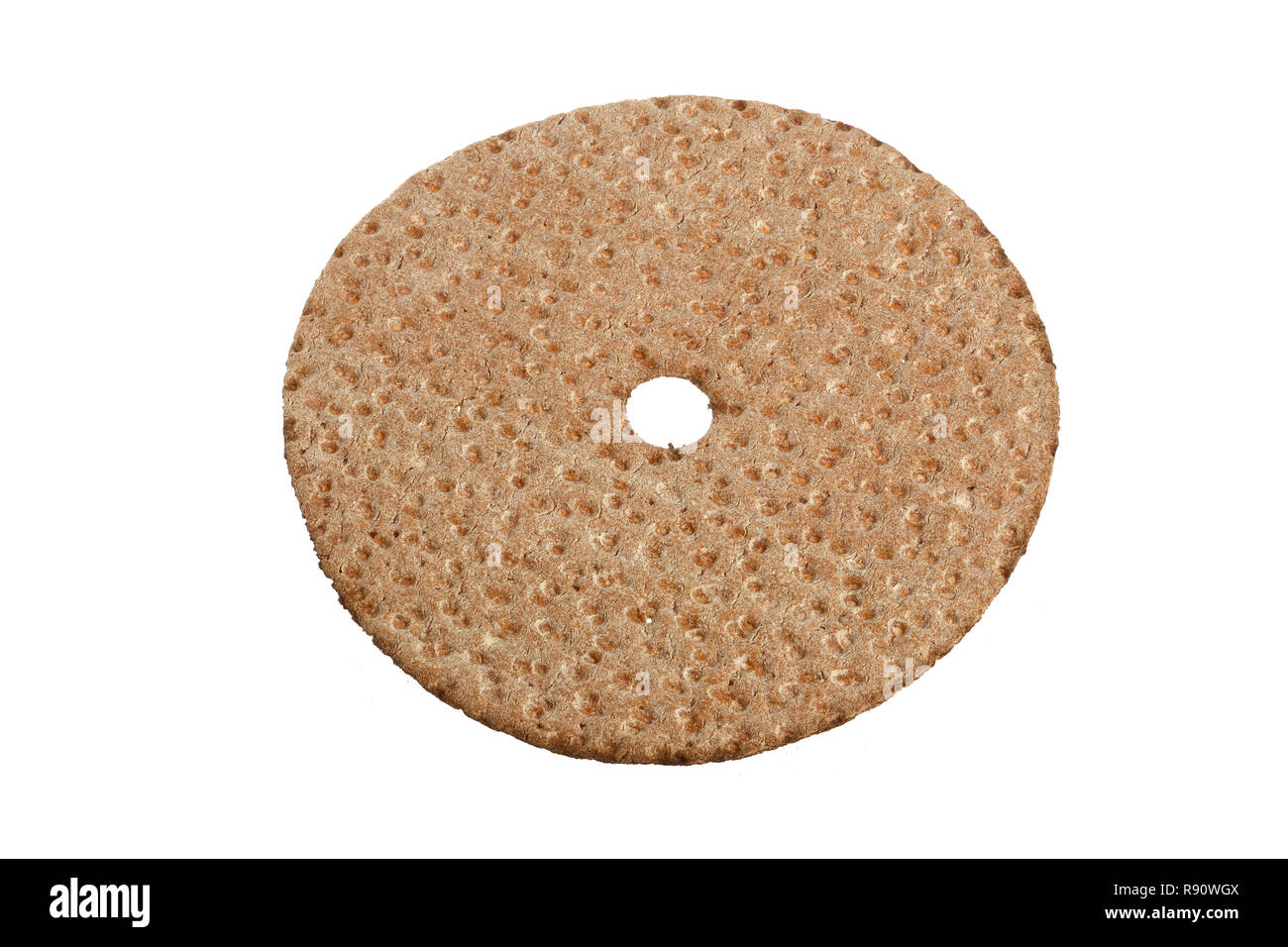 High angel view of a traditional Swedish crisp bread made of rye isolated on white background. - Stock Image