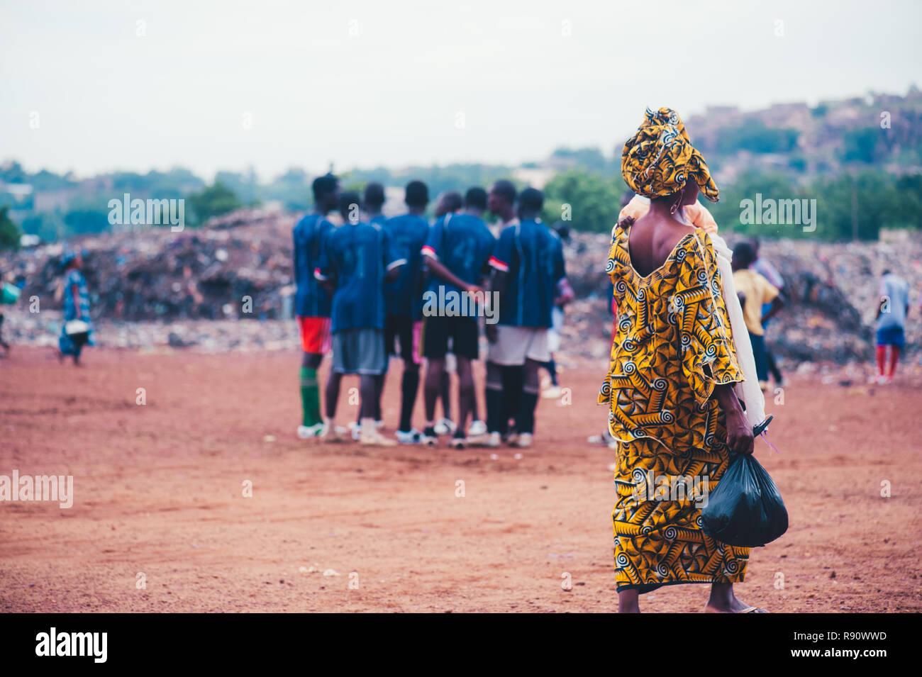 Mali Africa Black African Children Playing Soccer In A Rubbish Dump With Their Parents Crossing The Game Field Rural Area Near Bamako Stock Photo Alamy