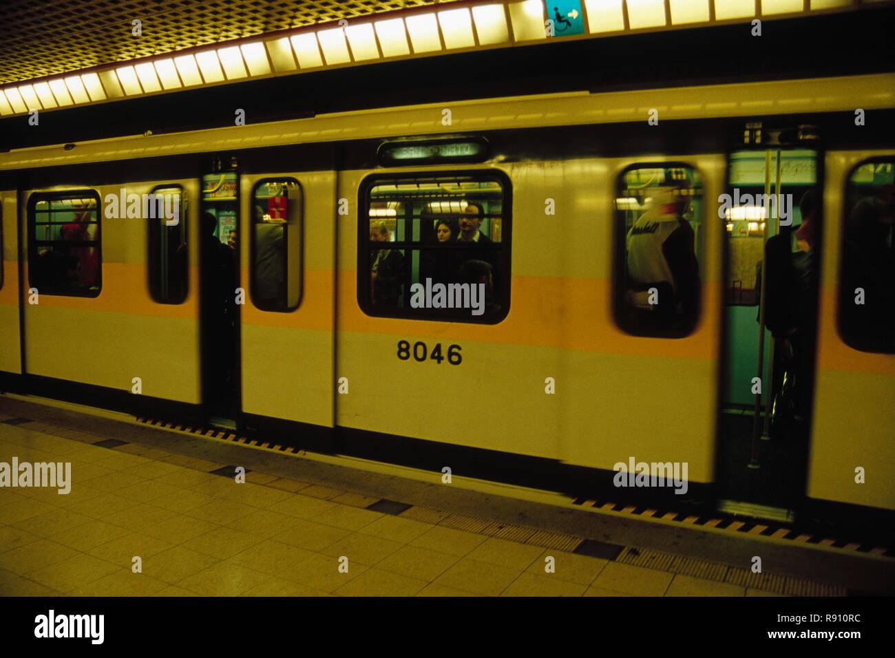 underground metro railway station platform, yellow line, milan, italy - Stock Image