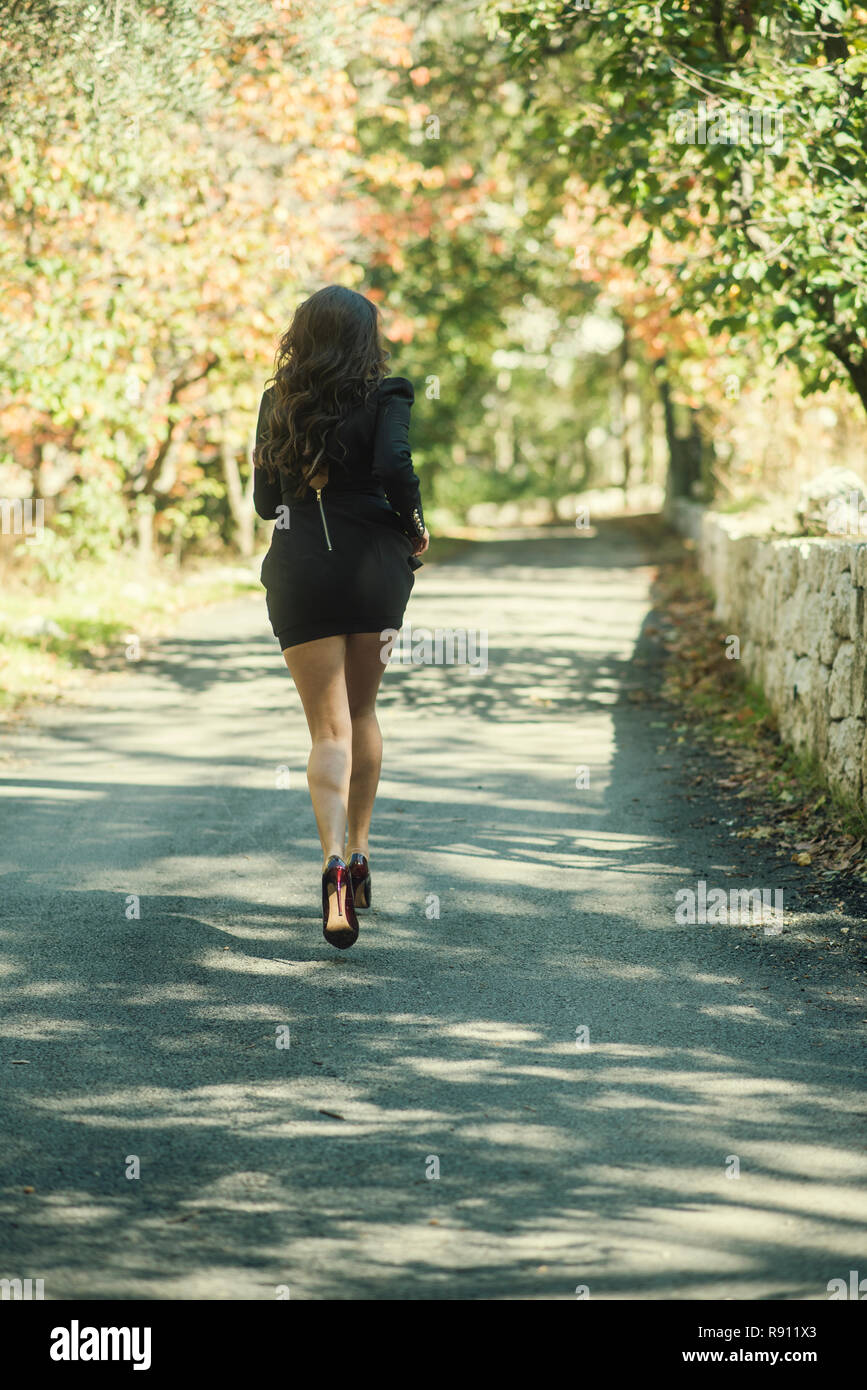 Rear view of a woman running away Stock Photo