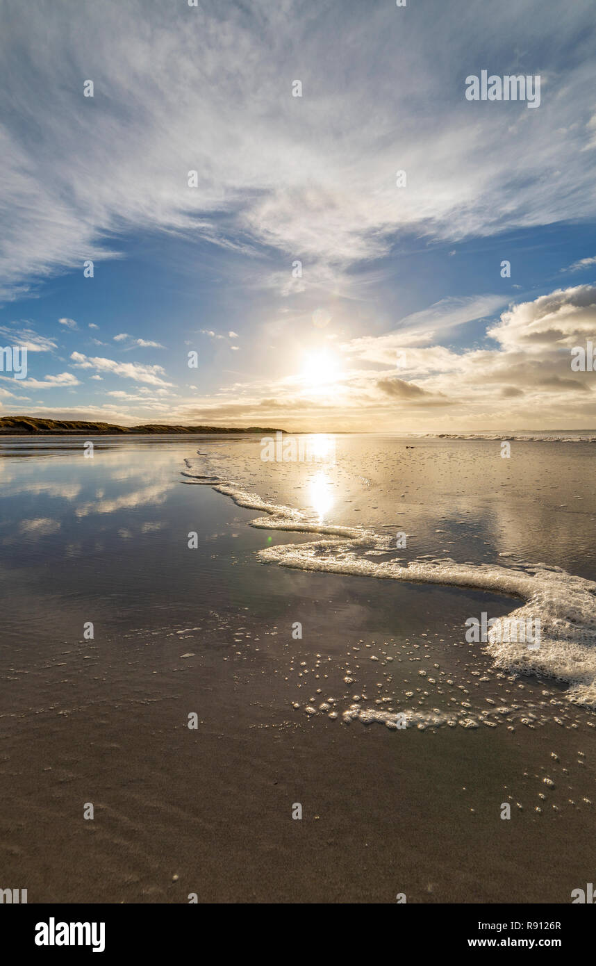 Wide angle shot of the ebb and flow of the sea on Ard Michel beach, South Uist, Outer Hebrides, Scotland - Stock Image