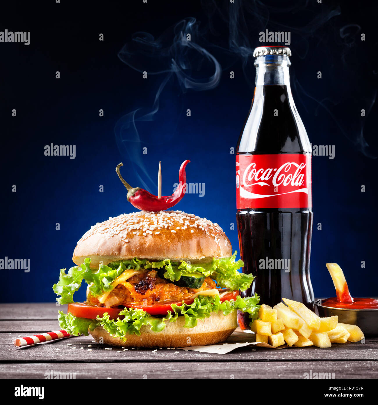 MUMBAI, INDIA – MAY 23, 2015: Veggie burger, French fries and Coca-Cola bottle - is the most popular carbonated soft drink beverages sold around the w - Stock Image