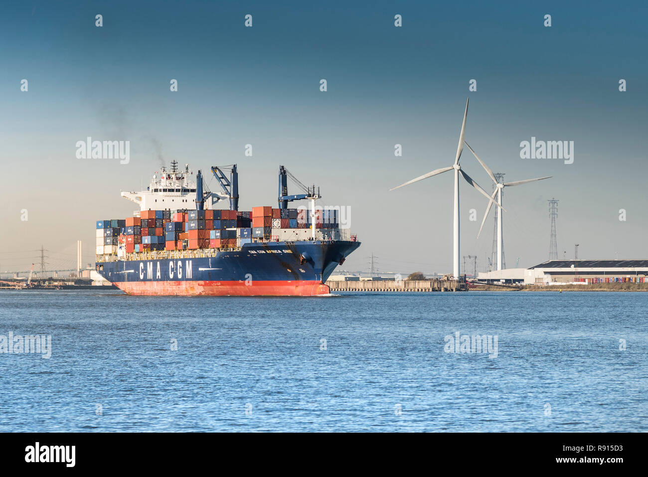 Shipping on the Thames.  The CMA CGM Africa One container ship leaving the Port of Tilbury and steaming downriver on the River Thames. - Stock Image