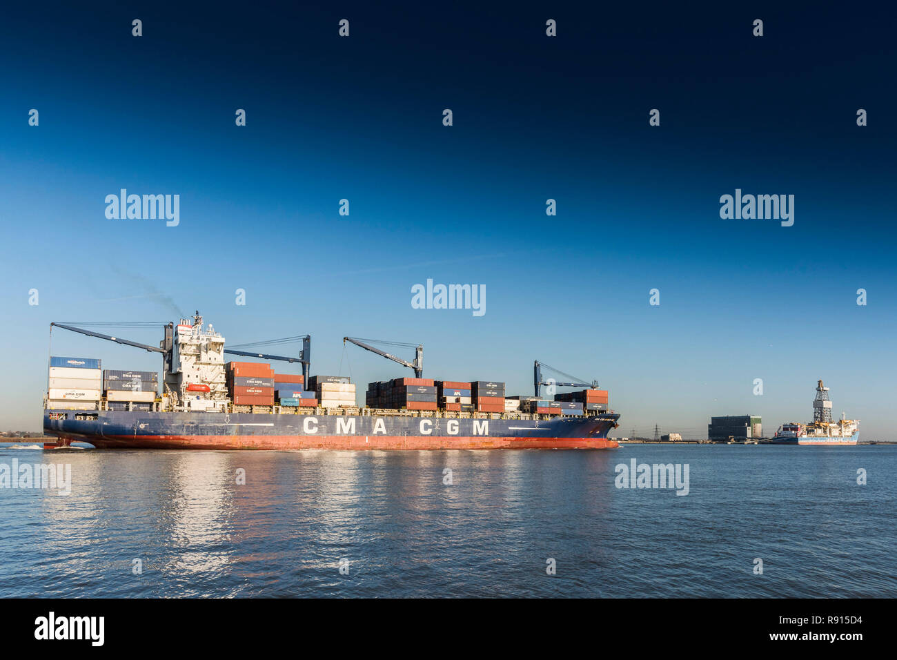 Shipping on the Thames.  The CMA CGM Africa One container ship lteaming downriver on the River Thames. - Stock Image