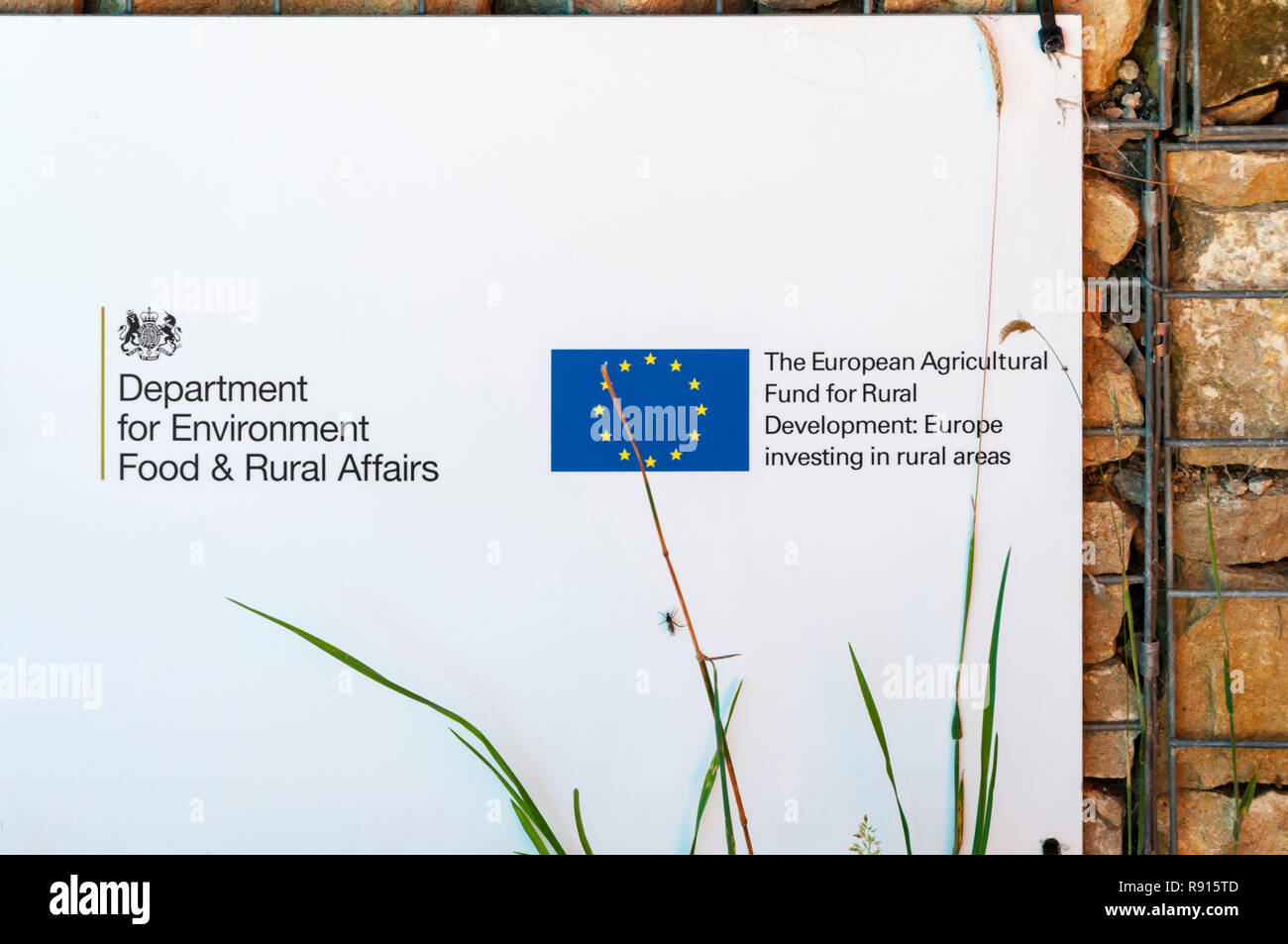 A sign at Bempton Cliffs acknowledges aid from The European Agricultural Fund for Rural Development. - Stock Image
