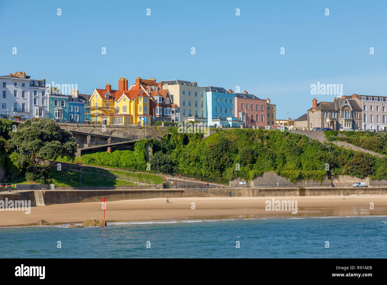 Colourful houses above the harbour and North Beach in Tenby, a walled seaside town in Pembrokeshire, south Wales coast, western side of Carmarthen Bay - Stock Image