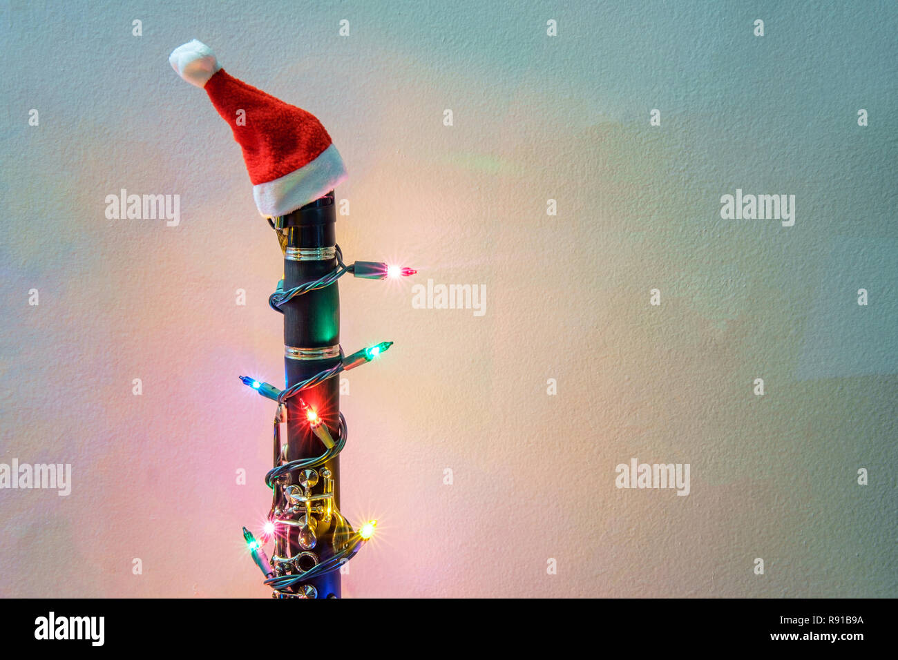1ceb2a8aaaa7b Seasonal holiday musical instrument clarinet with Christmas santa hat and  lights