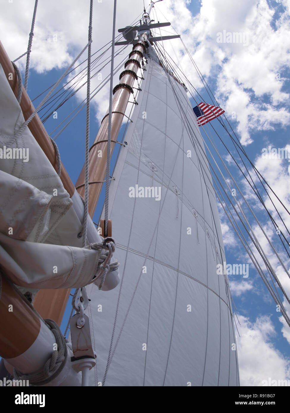 Looking Up at Main Sail on a Sunny Day on a Sailboat - Stock Image