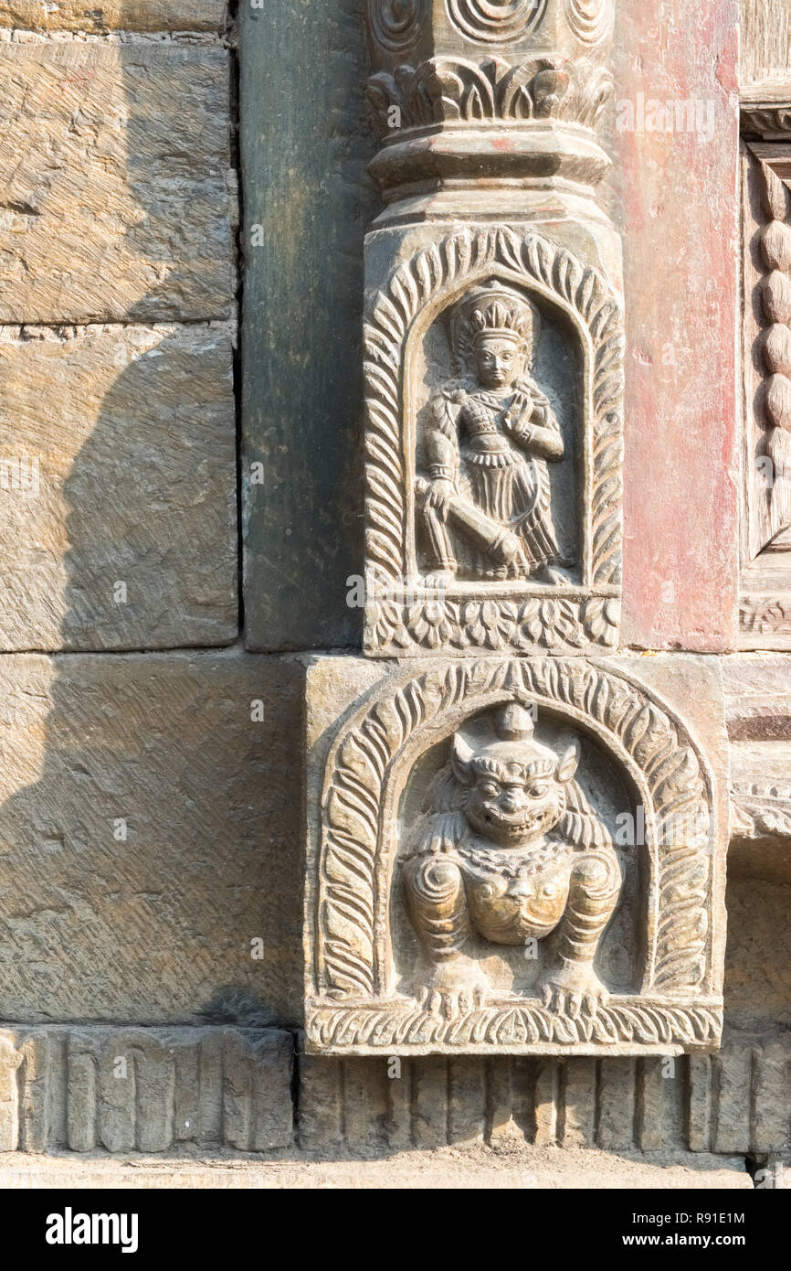 Hindu deities / gods carved into stone temple,  Pashupatinath Temple, Kathmandu, Nepal - Stock Image