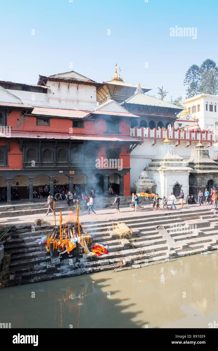 Cremation ghats at Pashupatinath Hindu temple complex, Kathmandu, Nepal - Stock Image