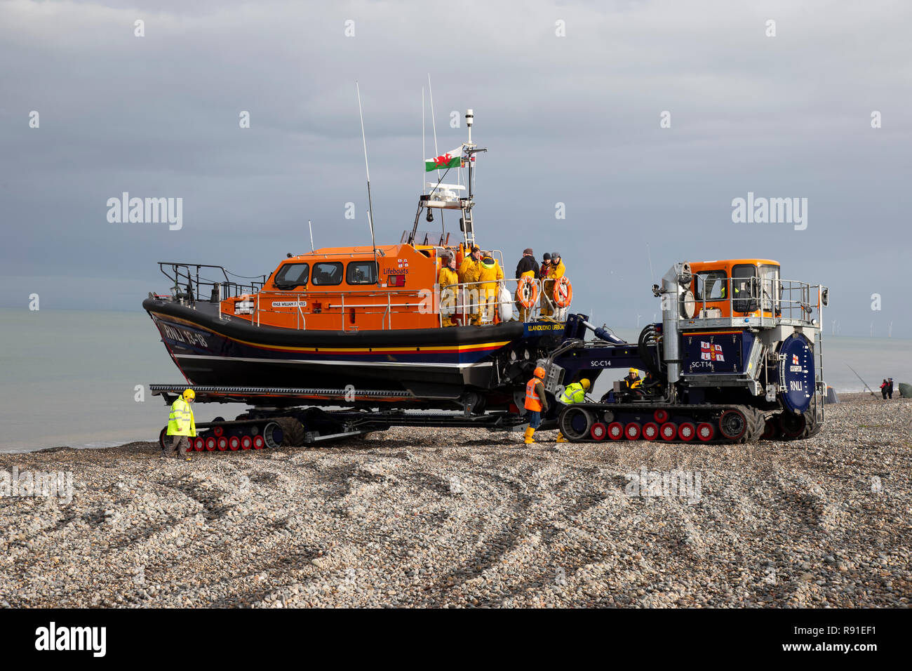 RNLI Shannon Class Lifeboat William F Yates is retrieved from the sea at Llandudno's North shore following sea exercises - Stock Image