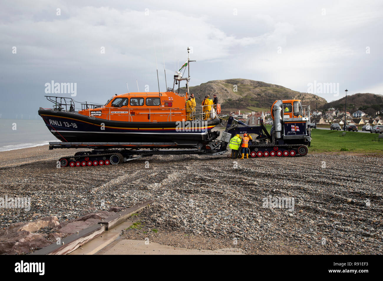 RNLI Shannon Class Lifeboat William F Yates is retrieved from the sea at Llandudno's North shore following sea exercises Stock Photo