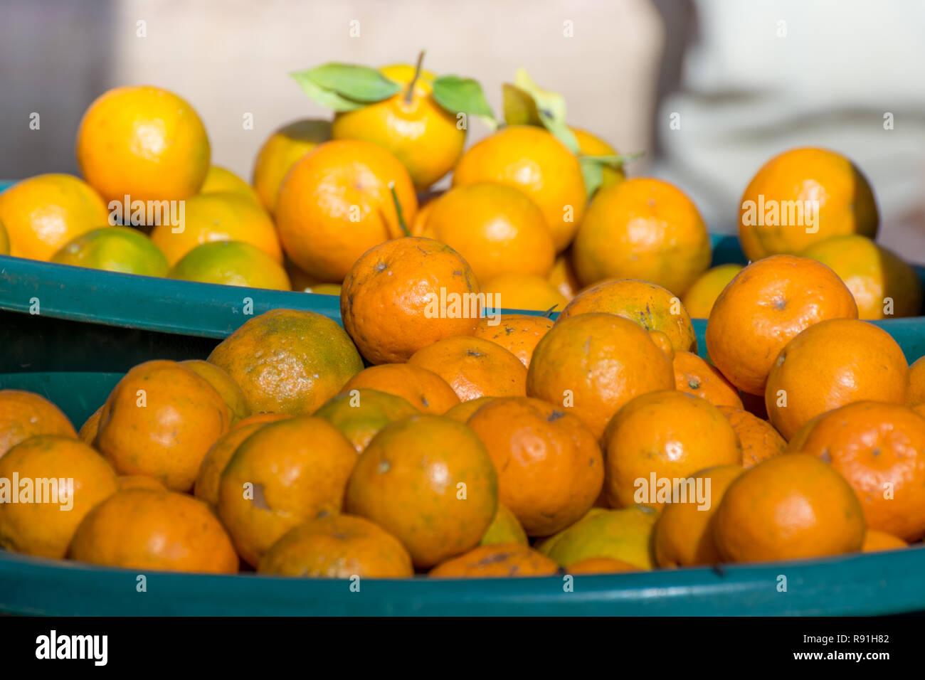 Fresh oranges, oranges background, bunch of fresh organic oranges - Stock Image