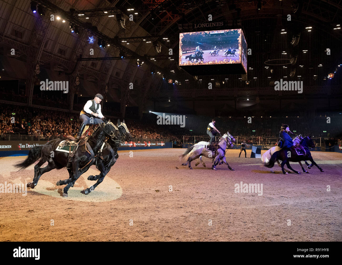 The Devil's Horsemen perform during day two of the London International Horse Show at London Olympia. - Stock Image