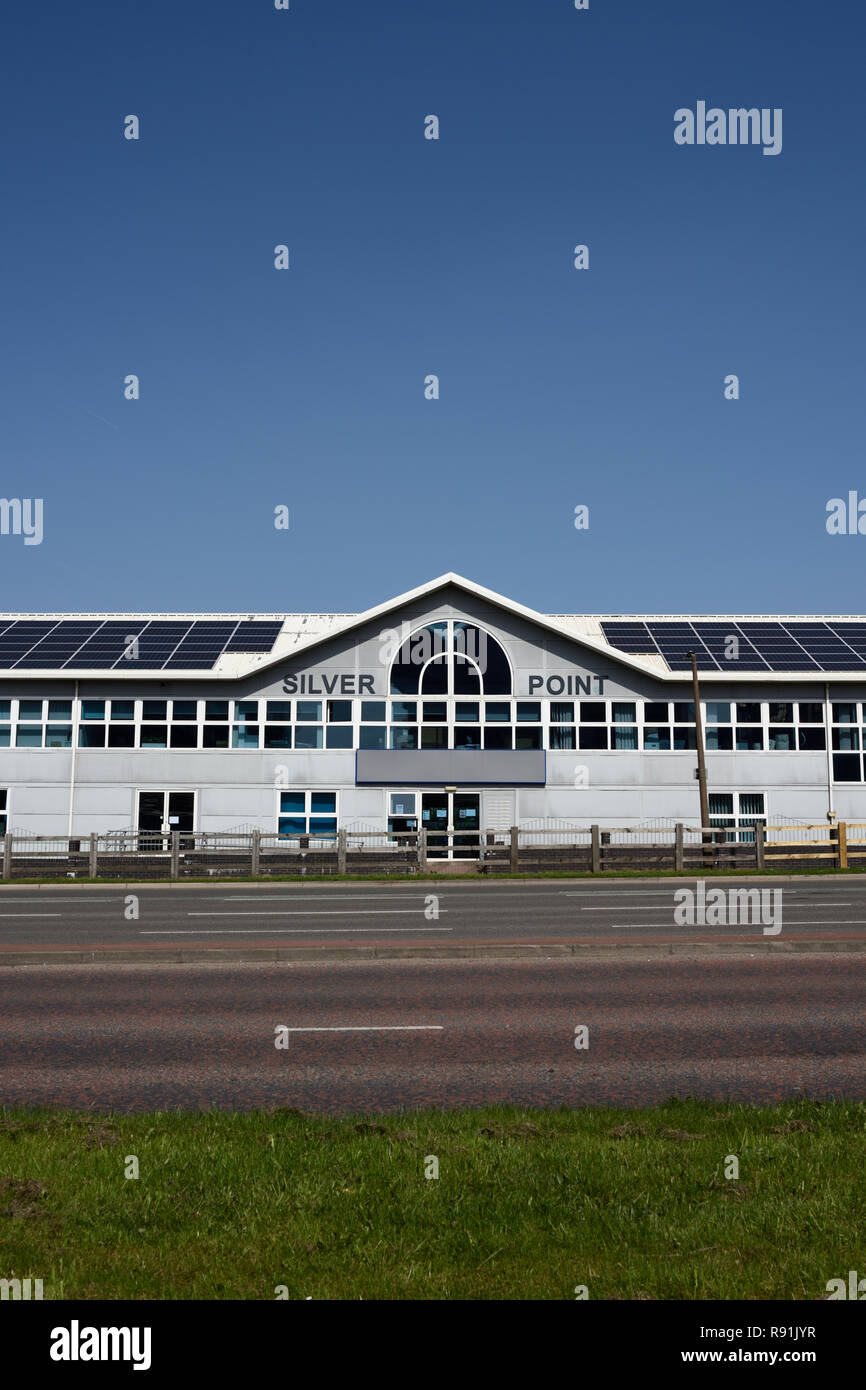 Photovoltaic panels on commercial building with clear blue sky, in bury lancashire uki - Stock Image