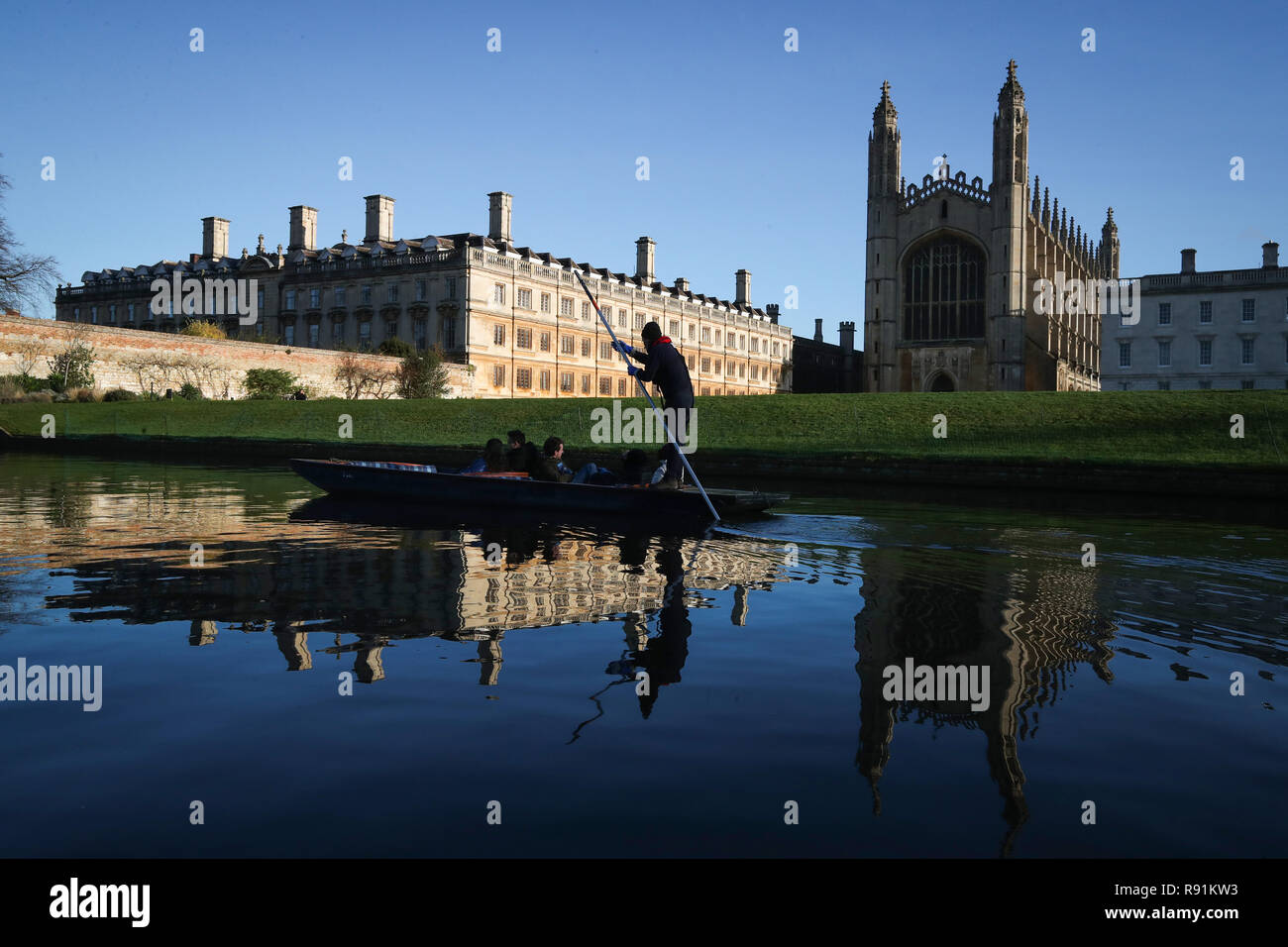 A punt chauffeur makes his way  along the river Cam in Cambridge. Stock Photo