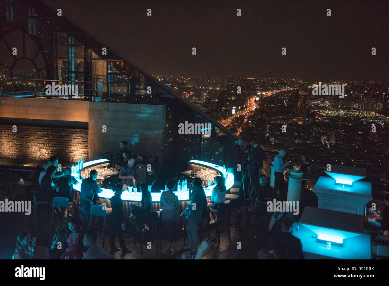 Looking out on the Bangkok cityscape from the Lebua No. 3 bar, Bangkok, Thailand - Stock Image