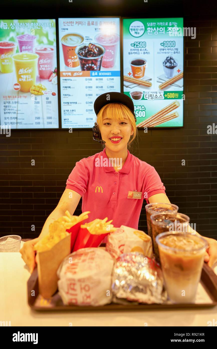 BUSAN, SOUTH KOREA - CIRCA MAY, 2017: worker at McDonald's. McDonald's is an American hamburger and fast food restaurant chain. - Stock Image
