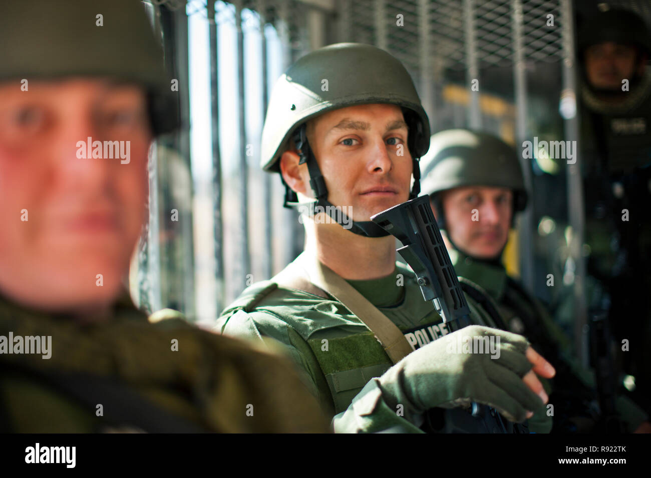 Portrait of three police officers at a training facility. - Stock Image