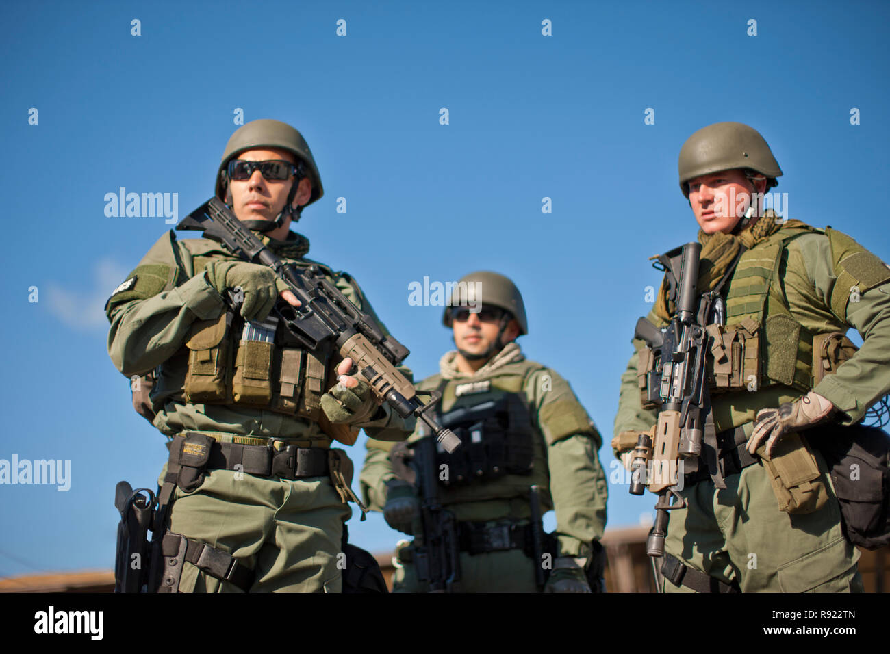 Three police officers at a training facility. - Stock Image