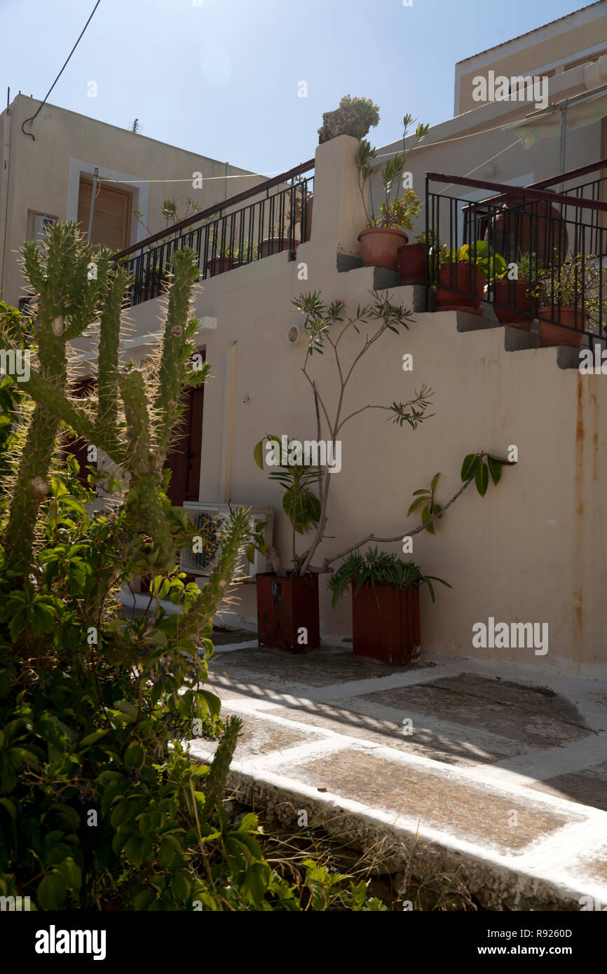 potted plants and stairs vourkari kea cyclades greece - Stock Image