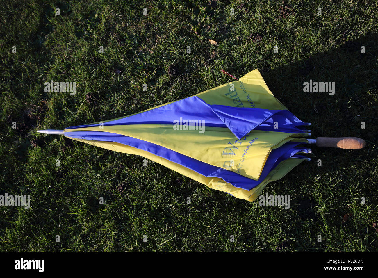Yellow and Blue Large Promotional Umbrella Jonathan Wren Financial Recruitment Consultants - Stock Image